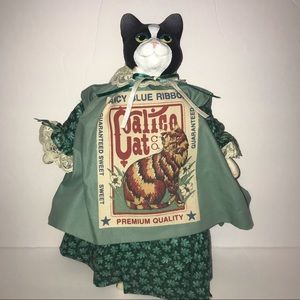 Calico Cat Doll In Green Dress